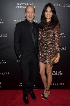 """Emma Heming Willis Photos Photos - Actor Bruce Willis (L) and Emma Heming attend """"Battle Of Versailles"""" New York Premiere at Paris Theater on March 3, 2016 in New York City. - 'Battle of Versailles' New York Premiere - Arrivals"""