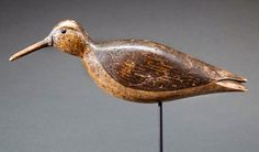 COPLEY FINE ART AUCTIONS The Sporting Sale 2015 July 25th, 2015 Lot 86 (left side). Running Curlew by Nathan F. CobB Jr. (1825-1905) Cobb Island, VA, c. 1880. This bold decoy features a classic Cobb tail split, an original oak bill and black glass eyes within carved eye grooves. While Cobb curlew decoys are rare, this bird with its original paint and bill is a particularly noteworthy example. This early gunning decoy has impeccable provenance, coming directly to the consignor from renowned…
