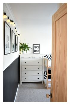 Scandi-inspired boys' bedroom with chalkboard wall, IKEA bed and Hemnes chest of drawers.