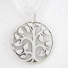 """Round Cut Out Design Tree of Life Pendant in Sterling Silver on a 16"""" box chain, #8458 Taos Trading Pendants. $49.00. The tree of life is a powerful, life-affirming symbol in almost every culture.. This sterling silver tree of life pendant is 3/4"""" x 3/4"""" and stamped 925. The pendant comes on a 16"""" sterling silver box chain.. You can visit our Taos Trading storefront to view more styles and jewelry designs.. With its branches reaching towards the sky, and roots embe..."""