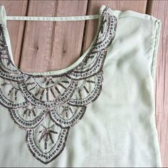 Embellished top Open back, sheer fabric with beautiful detailing. Mint color Decree Tops