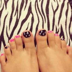 Black and pink, crosses.