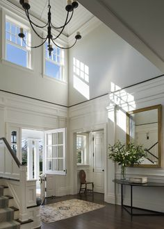 wonderful Dutch door: bottom solid, top paned; like the recessed area to the right, must be the coat closet..