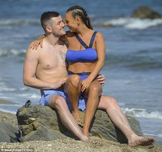 Beaming: Perching on the rocks, Chantelle sat on her beau's lap looking lovingly into his eyes