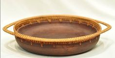 These unique Rattan trays are handmade in beautiful Bali. Made by artisans who learned their skills from previous generations, these tray can be used for a variety of purposes. They feature wood bowls with Rattan rims. They come in 3 different sizes  Handmade in Bali  Small - 10.5 x 9 x 2 IN  Medium - 12.5 x 10.5 x 2.5 IN  Large - 15 x 12 x 2.5 IN