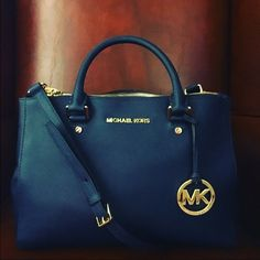 Michael Kors Sutton Saffiano Leather Satchel Gently used pre-owned Navy/Gold medium satchel. MICHAEL Michael Kors Bags Satchels