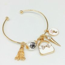 Open bangle Bracelet, charm bag ,lady charm, pearl  bracelet charm , wedding bracelet, bridesmaid gift, gold color bracelet, trend bracelet, by bracelet charms, gift for her, Christmas gift,  This beautiful bracelet comes with a charm medalion ...