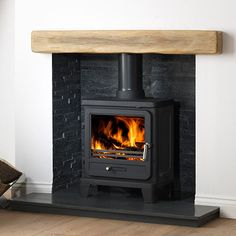 The Helios 5 Cleanburn Wood Burning and Multi Fuel Stove is an addition to the Gallery range of stoves. The Gallery Helios 5 is a wood burning stove that is Defra approved, so can be used in smoke controlled areas. Wood Burner Fireplace, Inglenook Fireplace, Fireplace Hearth, Home Fireplace, Modern Fireplace, Living Room With Fireplace, Fireplace Design, My Living Room, Fireplaces