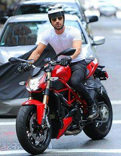 Justin Theroux in his Ducati