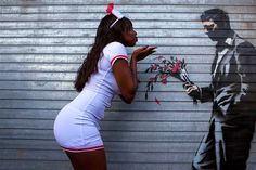 New Yorkers interact with Banksy.