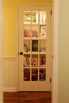 Turn a coat closet into a library with shelves and a french door. Very clever!