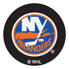 Get on the scoreboard with the New York Islanders Hockey Puck Area Rug. This hockey puck shaped area rug is chromojet printed, allowing for unique, full penetration of the color down to the entire tuf