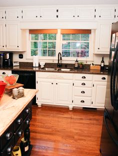 Updated kitchen painted cabinets-2. I like the idea of adding feet, and the darker painted island