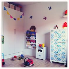 Wallpaper covered drawers, bunting, kids room details
