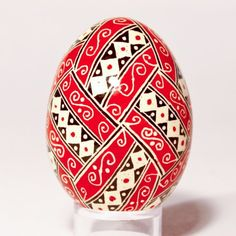 red white black egg with diamond division