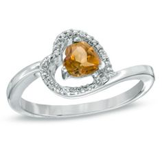 Delight your November-born birthday girl by giving her your heart - wrapped in diamonds and polished sterling silver! This elegant ring features a heart-shaped frame lined with shimmering diamond accents and a 5.0mm heart-shaped citrine at its center. Set at a sweet sideways angle on the polished band, this exquisite ring is one she'll be proud to wear again and again. Custom made to fit her ring size, sterling silver rings cannot be resized after purchase.