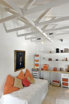 By crashing through the existing eight-foot ceiling and exposing the roof joices, this homeowner was able to give her 1970s house 12-foot ceilings. She unified the look by painting the beams and walls Moonlight, a white Benjamin Moore shade. She said it was the boldest but most important past of her renovation of the house.