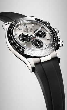 Rolex Cosmograph Daytona in 18ct white gold with a black monobloc Cerachrom bezel in ceramic, a steel dial and the patented Oysterflex bracelet in elastomer .