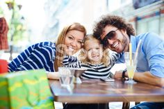 Cheerful Family Sitting In A Restaurant Outdoors And Making Selfie. Royalty Free Stock Photo With coupon codes and promotional codes.