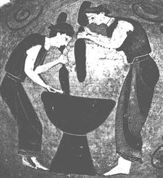 two women standing lifting large stones