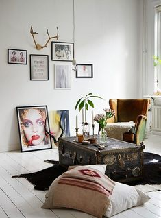 Decor Inspiration - trunk as coffee table, staggered art on the walls, avocado plants in vases