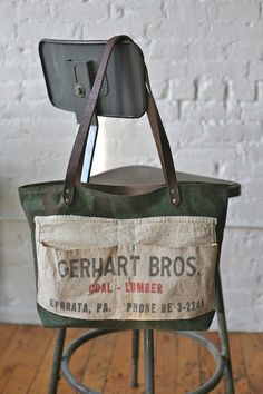Idea:  sew feed sack on a canvas tote.  Decorate or make pockets.