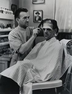 Greek-born American make-up artist Jack P. Pierce applies make-up and combs the hair of British actor Boris Karloff for Karloff's role as the monster in the James Whale-directed film 'Frankenstein,' California, Boris Karloff Frankenstein, The Frankenstein, Rare Photos, Vintage Photos, James Whale, Barber Shop Decor, Frankenstein's Monster, Famous Monsters, Classic Monsters