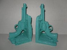 Teal Gun Book Ends / Modern Decor / Office / Library / Book Ends / Shabby Chic Decor. $31.00, via Etsy.