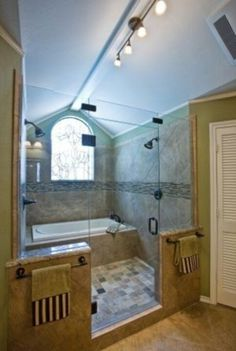 Bathtub in shower. With a lower and bigger window, it would be even better!
