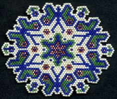 These patterns are my older patterns that I hand colored on graph paper, no instructions, color code or count provided. I designed this pattern to be used as an ornament or suncatcher. You may add a loop of beads or thread a loop of clear fishing line through the top and tie a knot. After the