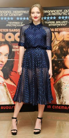 Amanda Seyfried at a London screening of her film Lovelace. Gucci blouse and skirt from the Resort 14 collection. Givenchy sandals.