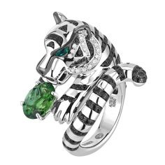 Bagha, the tiger ring Tourmaline  Ring set with a green oval tourmaline, and pavé diamonds, two black sapphires and two cabochon emeralds, in white gold