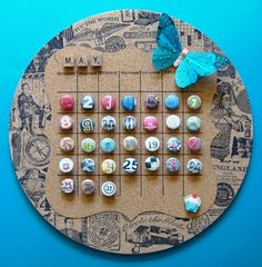 Perpetual Calendar on cork with push pins & lots of vintage-style stamped images.