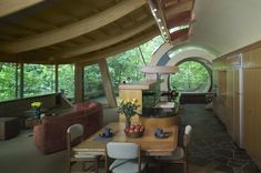 I could easily live like this...! A wide eave on the curved roof helps reduce solar gain that can come from the heavy use of glass. Image by Cameron Neilson via Robert Oshatz.http://www.earthtechling.com/2013/02/a-treehouse-to-please-both-ewok-and-hobbit/