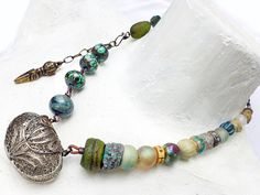 My Store of Secrets. Cosmic Victorian Assemblage statement art necklace with locket box and iridescent beads..