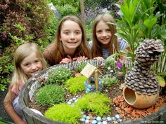 Magical Fairy Garden with moss, a well and a gourd gnome home -  More gorgeous photos of this magical FAIRY GARDEN on The Magic Onions Blog and FairyGardens.com