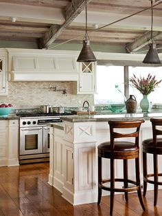 Lighting above your kitchen island adds practical task lighting as well as a decorative touch to a hardworking room.