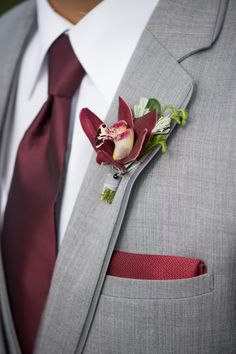 wine cymibidium orchid boutonniere by HANA, image by Justin and Mary