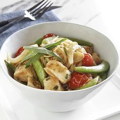 This is such an easy dinner—just quickly stir fry chicken and veggies and serve over pasta. Yum!