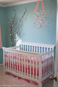 "Love this nursery's color scheme! And adore the ""cherry blossom"" look."