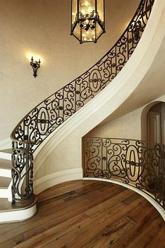 Beautiful Stairs love the color, graceful spiral and railings. photocyril