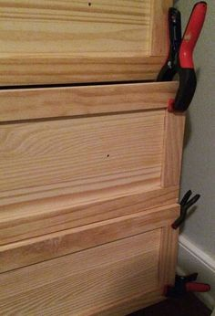Master Bedroom Night Stand Tutorial (IKEA Tarva Hack)  I used liquid nails and added some thin pieces of wood to sort of frame out each drawer. I used clamps to hold them in place until the liquid nails dried