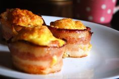 bacon and eggs in a cupcake. so easy and yummy. First arrange one piece of uncooked bacon in a muffin cup. The add the eggs. You can scramble the eggs first or just crack them straight into the bacon lined cupcake. Gotta try with turkey bacon and egg whites next time.