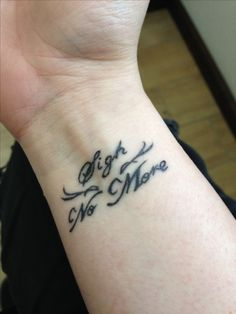 "My second Mumford and Sons tattoo  ""Sigh no More"" on my wrist, I love it."