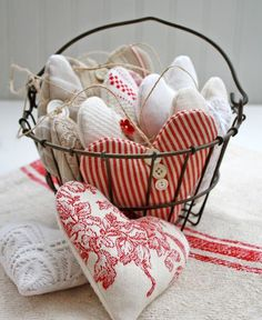 Valentine DIY decorations.  batch of hearts made from red and tan French-inspired fabrics. They're stuffed with fragrant lavender.