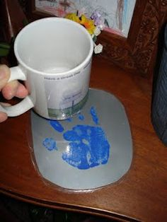 Handprint coaster. Laminate it to make it last--and so it is washable.