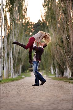 CUTE!! Love that he is picking her up!