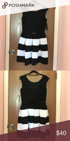 Black and white striped dress Sleeveless black and white dress. Never worn. tiana Dresses
