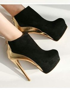 black and gold stiletto high heels pumps women shoes fashion http://www.womans-heaven.com/black-and-gold-stiletto-heels/