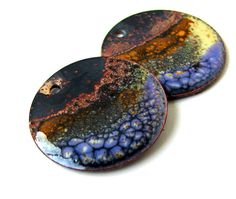 Reserved listing...thank you!! Beautiful orange, yellow and purple blending with fired brass showing through... This listing is for 2 handmade, torch-fired enameled (on both sides) charms measuring 19mm with a 1.5mm hole. Please feel free to convo me with any questions you may have